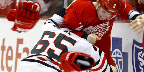 March 4, 2012; Detroit, MI, USA; Detroit Red Wings defenseman Brendan Smith (2) and Chicago Blackhawks center Andrew Shaw (65) fight in the second period at Joe Louis Arena. Mandatory Credit: Rick Osentoski-USA TODAY Sports